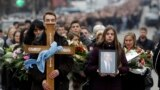 People take part in a mourning procession for Oliver Ivanovic in Mitrovica on January 17.