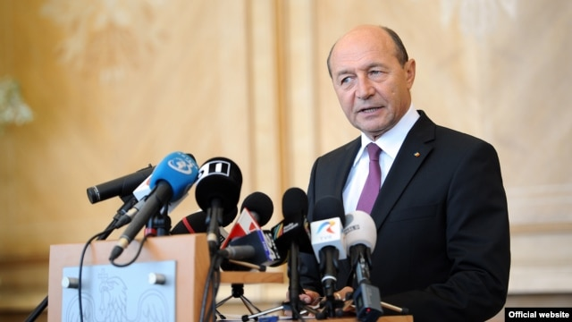 Romanian President Traian Basescu (pictured) has a secret plan to annex Moldova, says Russian Deputy Prime Minister Dmitry Rogozin.