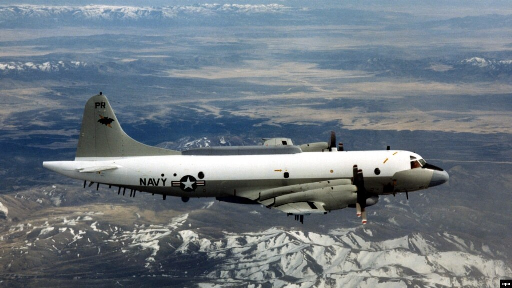 A U.S. Navy EP-3 is shown flying over an unknown location.