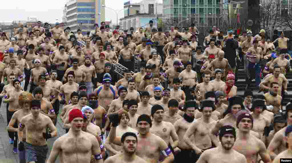 Half-naked participants run in the Real Men's Race to mark Defender of the Fatherland Day in Minsk on February 23. (Reuters/Vasily Fedosenko)