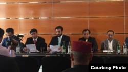 Brahamdagh Bugti (c) reading from a paper during a party meeting in Geneva on September 19.