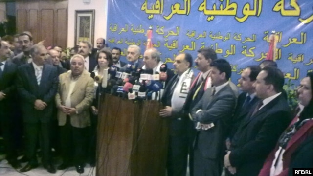 Salih al-Mutlaq, an influential secular Sunni politician (with hand on lectern), helping announce the creation of the Iraqi Patriotic Movement in October.