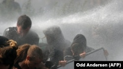 Riot police use water cannon against protesters in Hamburg during the G20 summit in Hamburg on July 7.