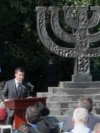 Ukrainian President Volodymyr Zelenskiy delivers a speech next to a monument commemorating the victims of Babyn Yar, one of the biggest single massacres of Jews during the Nazi Holocaust, during a ceremony in Kyiv on August 19.