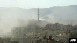 """Дамаск шетіндегі түтін. Осы күні көтерілісшілер """"үкімет әскері химиялық қару қолданды"""" деген ақпарат таратты. Сирия, 21 тамыз 2013 жыл."""