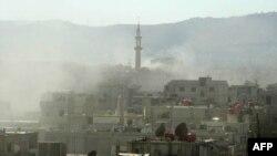 Дим над будинками в передмісті Дамаска Гуті після ймовірної хімічної атаки урядових сил, 21 серпня 2013 року