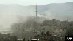 Syrian activists distributed this image showing smoke above buildings following an alleged toxic gas attack on August 21.