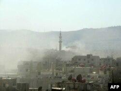 Дым над пригородом Дамаска Гхутой, как говорят повстанцы - химический газ