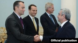 Armenia - President Serzh Sarkisian (R) meets with the visiting foreign ministers of Bulgaria, Poland and Sweden in Yerevan, 14Dec2012.