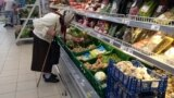 RUSSIA -- An elderly woman chooses vegetables in a supermarket in Dmitrov, a Russian town 75 km., (47 miles) north from Moscow, Russia, Saturday, July 2, 2016.