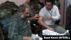 مشهد من حملة التلقيح ضد الانفلونزا في بغداد