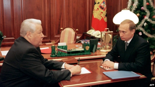 Russia President Boris Yeltsin speaks with then-Prime Minister Vladimir Putin at the Kremlin on December 31, 1999, the day that Yeltsin would resign and appoint the former KGB agent as the country's acting leader.