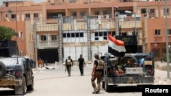 Iraqi security forces gather in center of Fallujah on June 20.