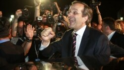 The leader of the conservative New Democracy party, Antonis Samaras, is cheered by supporters in Athens on June 17.