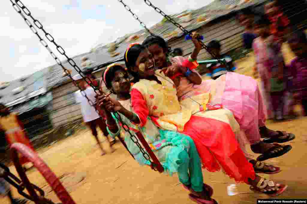 Rohingya refugee children ride on a swing ride in the Kutupalong refugee camp in Cox's Bazar, Bangladesh. (Reuters/Mohammad Ponir Hossain)
