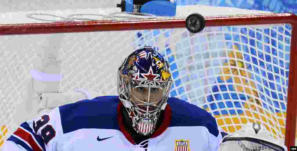 Goalie Ryan Miller of United States blocks the puck against Slovenia in the first period during their ice-hockey match. (epa/Larry W. Smith)