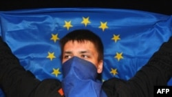 An opposition activist protests in downtown Minsk.