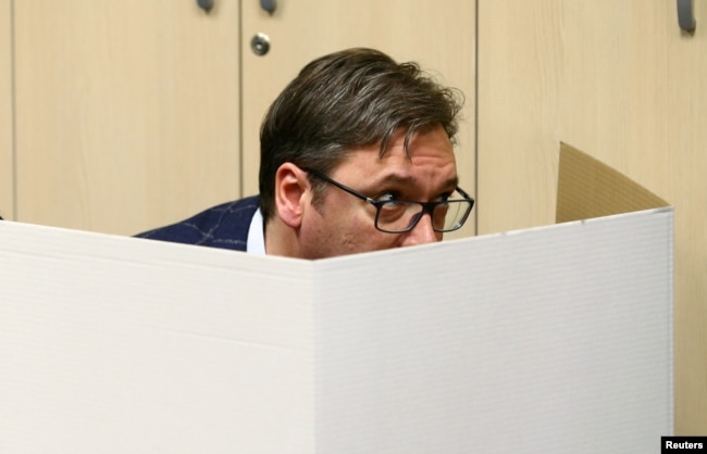 Vucic prepares his ballot at a polling station in Belgrade on April 2.