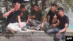 A screen grab from a video that purportedly shows the men who attacked foreign cyclists in Tajikistan.