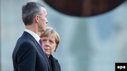 German Chancellor Angela Merkel (right) and NATO Secretary-General Jens Stoltenberg are among the leaders due to attend the Munich conference this year. (file photo)