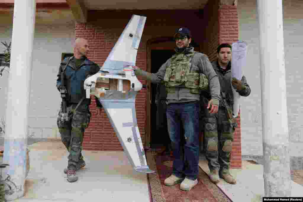 "U.S. Special Operations forces with what appears to be a Skywalker X8 drone, commercially available online. A drone like this was recorded loaded with explosives in a January 2017 IS propaganda video attacking coalition forces with what the Washington Post described as ""pinpoint accuracy."""