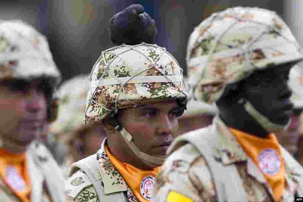 A pigeon perches on the helmet of a Colombian infantry soldier who will be deployed as part of the Multinational Force and Observers (MFO) peacekeeping force overseeing the terms of the peace treaty between Egypt and Israel in the Sinai Peninsula during a ceremony on Bolivar Square in Bogota. (AFP/Eitan Abramovich)