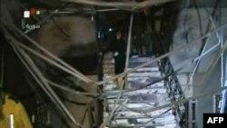 Телевизионные кадры разрушенного входа в здание сирийского МВД. Дамаск, 12 декабря 2012 года.