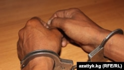 Kyrgyzstan - handcuffs, crime, undated