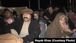 Arman Luni's elderly mother (R) and lawmaker and senior PTM leader Ali Wazir at his funeral late on February 3.