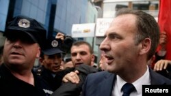 Fatmir Limaj greets supporters in Pristina after he was acquitted on September 17.
