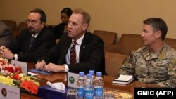 Acting Pentagon chief Patrick Shanahan (center) takes part in a meeting next to General Scott Miller (right), commander of U.S. and NATO forces in Afghanistan, and U.S. Ambassador to Afghanistan John Bass in Kabul on February 11.
