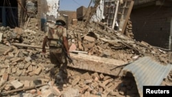 A Pakistani soldier walks at a house which was destroyed during a military operation in North Waziristan. (file photo)