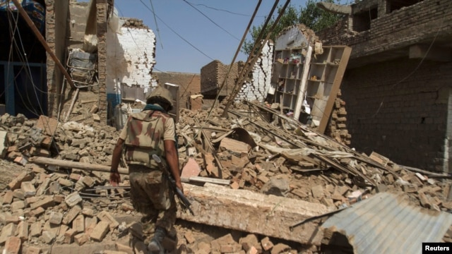 A Pakistani soldier walks at a house which was destroyed during a military operation against Taliban militants, in the of town of Miranshah, North Waziristan, on July 9.