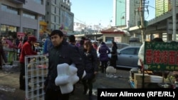 Many Kazakh traders travel across the border to China to buy goods to sell at home in local markets.