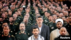 Former Iranian President Mahmoud Ahmadinejad (front row C) with commanders from the Basij Militia in Tehran May 7, 2006.