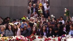 ARMENIA -- Armenians commemorate the anniversary of the Armenian genocide by laying flowers around the eternal flame inside the Armenian genocide memorial in Yerevan, April 24, 2018