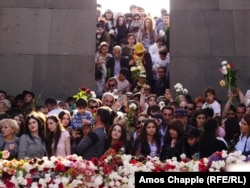 Armenians commemorate the anniversary of the mass killings by laying flowers around the eternal flame inside the Yerevan memorial.