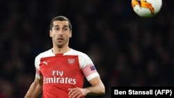 Arsenal's Armenian midfielder Henrikh Mkhitaryan keeps an eye on the ball during his team's Europa League quarter-final against Napoli earlier this year.