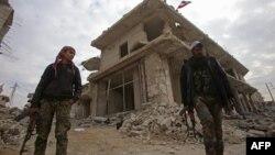 Forcat qeveritare siriane gjatë patrullimit të sotëm në qytetin Alepo