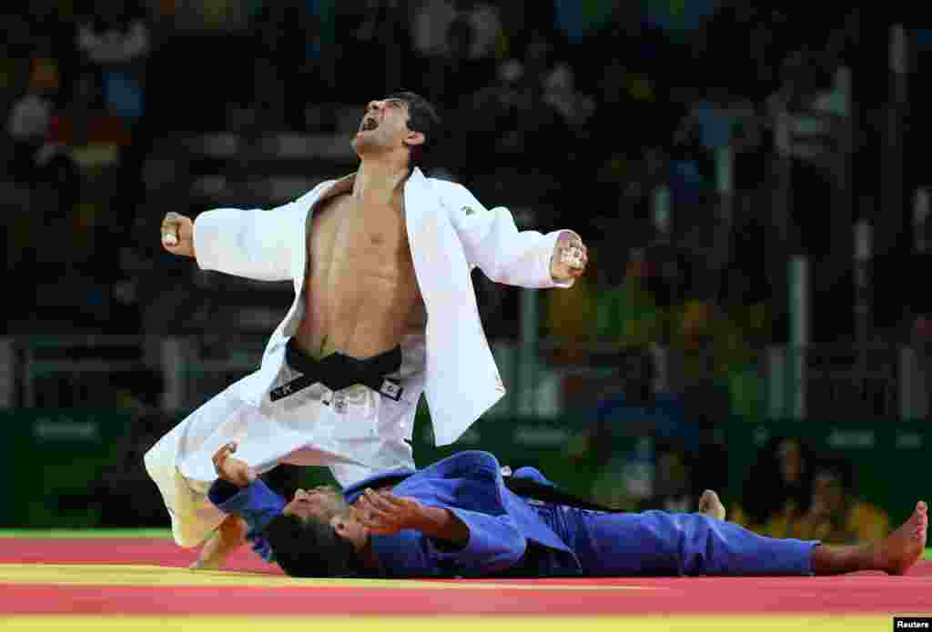 Lasha Shavdatuashvili of Georgia reacts after winning bronze by beating Sagi Muki of Israel in the men's 73- kilogram judo event.