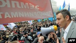 Boxer Vitaliy Klitschko addresses the crowds at the protest