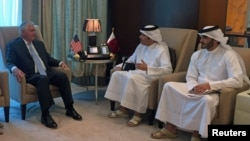 U.S. Secretary of State Rex Tillerson (left) meets with Qatari Foreign Minister Sheikh Muhammad bin Abdulrahman al-Thani (center) in Doha on July 11.