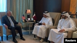 U.S. Secretary of State Rex Tillerson meets with Qatar's Foreign Minister Sheikh Mohammed bin Abdulrahman al-Thani (C) in Doha, July 11, 2017