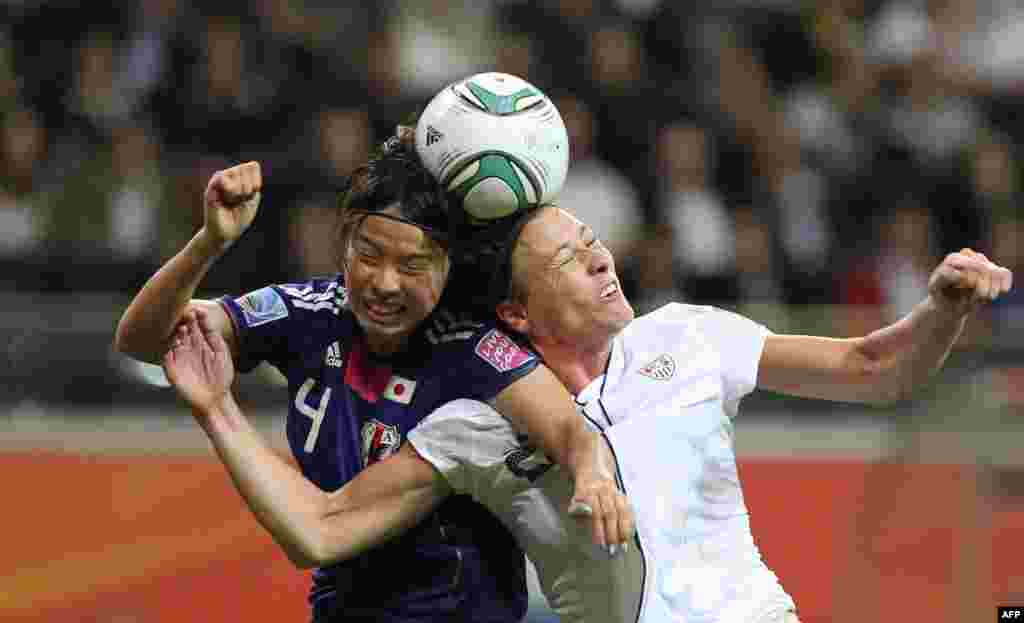 Japanese defender Saki Kumagai (left) and U.S. striker Abby Wambach compete for the ball in the final of the women's soccer World Cup in Germany on July 17. Japan won the tournament for the first time, in a penalty shoot-out after the match finished in a 2-2 draw following extra time.Photo by Daniel Roland for AFP