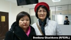 Адвокат Арона Атабека Жанар Балгабаева (слева) и его представитель Бахытжан Торегожина в Верховном суде Казахстана. Астана, 22 октября 2015 года.