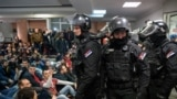 Protesters and police in state TV building downtown Belgrade, Serbia