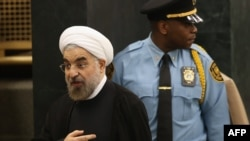 Iranian President Hassan Rohani departs after addressing the UN General Assembly in New York on September 24.