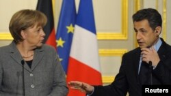 French President Nicolas Sarkozy (right) and German Chancellor Angela Merkel at the Elysee Palace in Paris on February 6