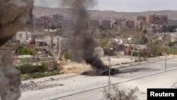 Дамаск түбіндегі ұрыс кезінде снаряд тиген танк. 19 наурыз 2013 жыл