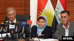 Kurdistan Alliance members discuss leaving the coalition government.